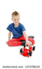 Cute little boy child kid preschooler playing with car toy. Isolated on white background