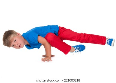 A cute little boy is dancing on the white background