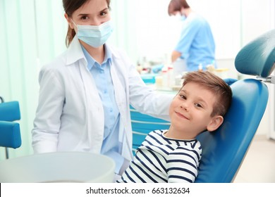 Cute little boy and dentist in clinic