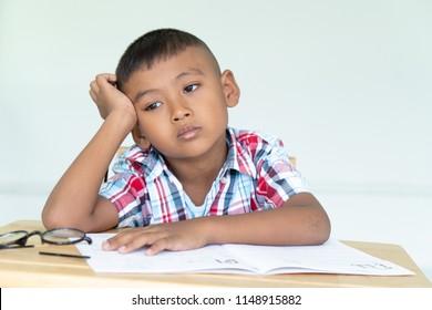 Cute little boy do not do homework