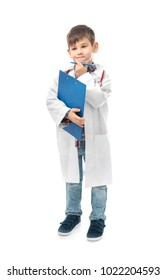 Cute little boy in doctor uniform with clipboard on white background