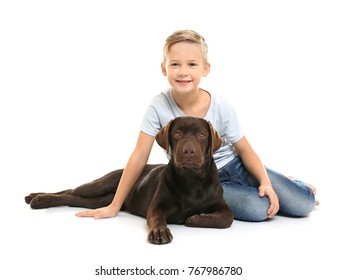Cute little boy with dog on white background
