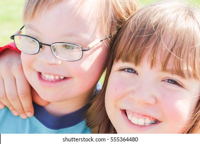 Cute Little Boy With Downs-Syndrome With Big Sister