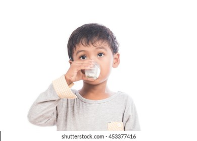 Cute little boy drinking milk