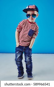 Cute little boy in elegant clothes and sunglasses. Kids fashion.
