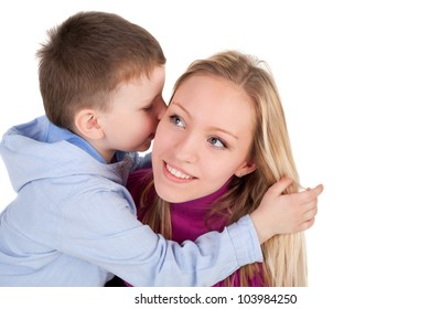 cute little boy embracing his beautiful mother