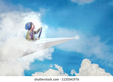 Cute little boy enjoy driving Paper Planes, Concepts, learning and imagination.