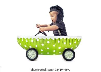 cute little boy enjoy a ride in green easter egg