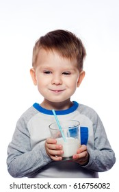 Cute little boy enjoying a milk