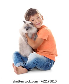 Cute little boy with fluffy cat on white background