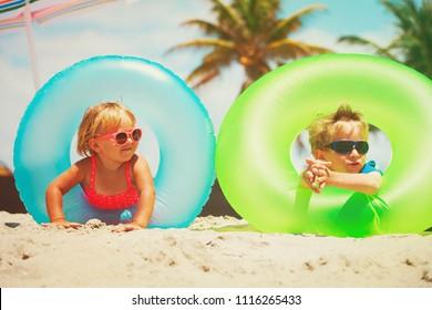cute little boy and girl play on beach