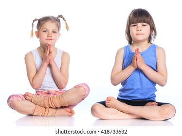Cute little boy and girl practice yoga. Isolated on the white background