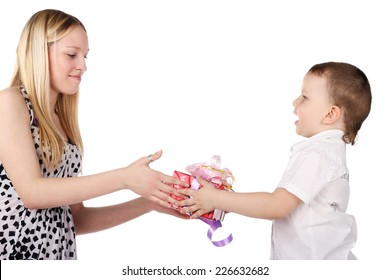 cute little boy giving a gift to the young beautiful blonde girl