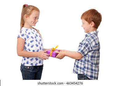 Cute little boy giving a present to the girl, isolated on white background