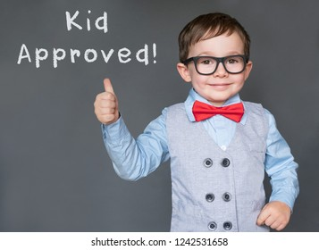 Cute little boy giving thumbs saying Kid approved