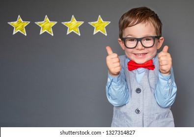 Cute little boy giving thumbs up with 4 stars approved