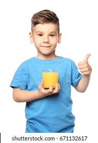 Cute little boy with glass of juice on white background