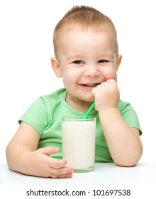 Cute little boy with a glass of milk, isolated over white