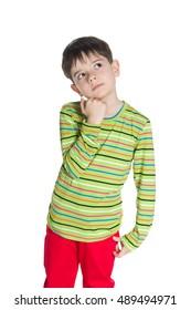 A cute little boy in a green striped shirt looks up