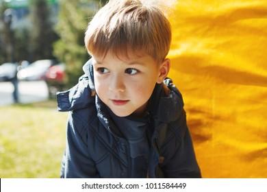 Cute little boy having fun in the park outdoors.