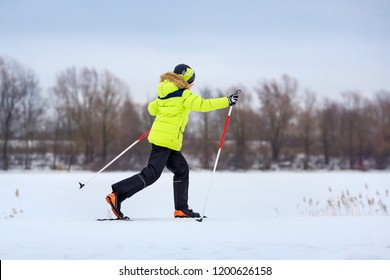 Cute little boy having fun during skiing on cross on cold winter day