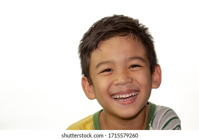 Cute little boy with healthy smile.  Close up face portrait Asian kid on white background.