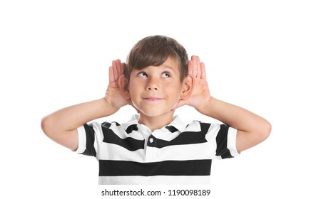 Cute little boy with hearing problem on white background