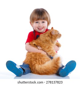 Cute little boy with his red cat smiling at camera on isolated white background