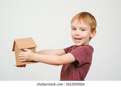 Cute little boy hold small house bank. Concepts saving money for House and Future.