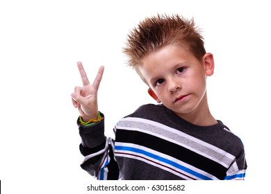 Cute little boy holding up the peace sign, wearing stripes on a white background
