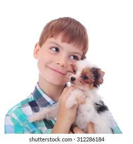 cute little boy hugging cute little puppy