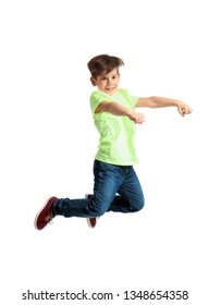 Cute little boy jumping against white background