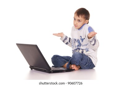 cute little boy with laptop on white