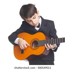 cute little boy learning guitar playing