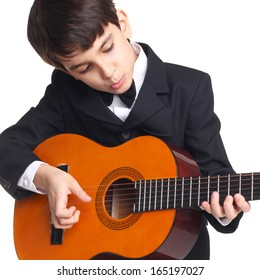 cute little boy learning play the guitar