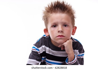 Cute little boy looking bored with his hand on his chin on a white background