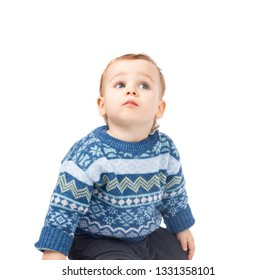 Cute little boy looking up isolated on white background