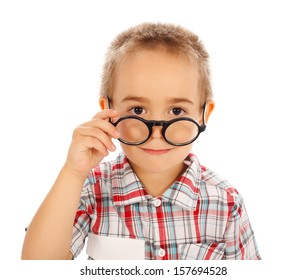Cute little boy looking over glasses. Isolated on white