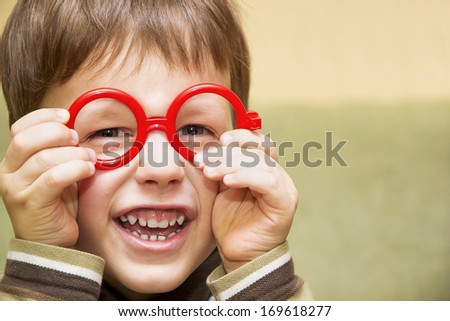 a6a7af09ef81 Cute Little Boy Looking Through Toy Stock Photo (Edit Now) 169618277 ...