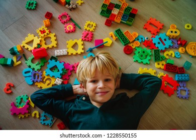cute little boy love playing with toys, puzzles and numbers
