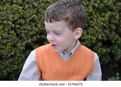 a cute little boy making faces