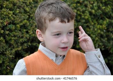 a cute little boy making faces 2