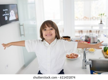 Cute little boy in the modern kitchen