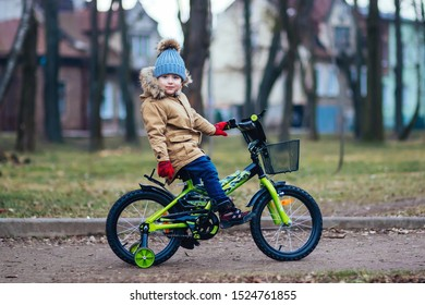 Cute little boy on bike in autumn park