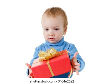 Cute little boy opens a gift box at Christmas or birthday and rejoices isolated on a white background, closeup