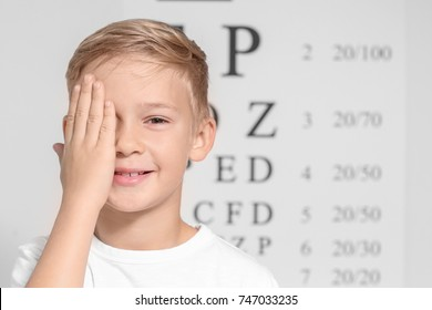 Cute little boy in ophthalmologist's office