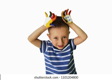 Cute little boy with painted hands