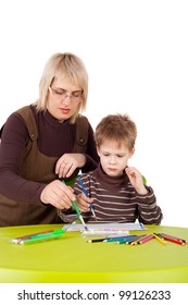 cute little boy painting with his mother
