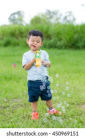 Cute little boy play with his toy