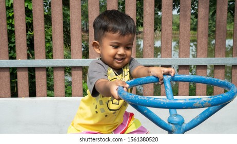 Cute little boy play at playground